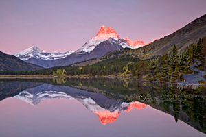 Mt. Wilbur, alpenglow, refleciton, sunrise, swiftcurrent Lake, reflection,