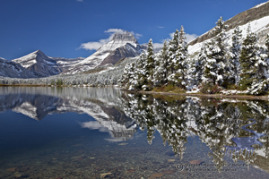 Mt. Wilbur, swiftcurrent Lake, autumn snow, reflection, many glacier, Glacier Naitonal Park, snow, winter, snow laden trees, Glacier National Park, babb, clear water, gin clear, blue sky, blue water, montana