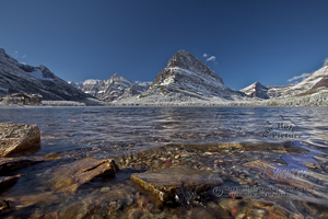 Swiftcurrent Lake, rocks, waves, Mount Gould, swiftcurrent lodge, blue sky, new snow, autumnMt