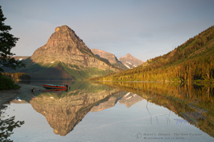 Two Medicine Lake, reflection, red boat, forest, blue sky,  Mt. Sinopah, glacier national Park, montana, clear water, nature