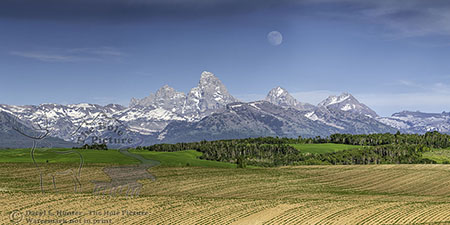 Full moon over Teton Valley Idaho and the Grand Tetons of Wyoming
