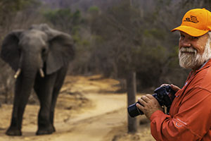 Daryl L. Hunter photographing elephant in Africa